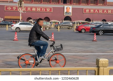 BEIJING, CHINA - 19 OCTOBER 2018: Cyclist on Mobike bike by Forbidden City in Tiananmen Square in Beijing