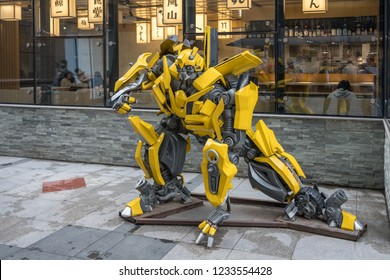 BEIJING, CHINA - 20 OCTOBER 2018: Yellow model of Transformers robot in The Place shopping mall