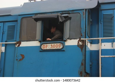 Beijing, China - 25 October 2012: A train driver controls the (CR DF7) diesel shunting locomotive.