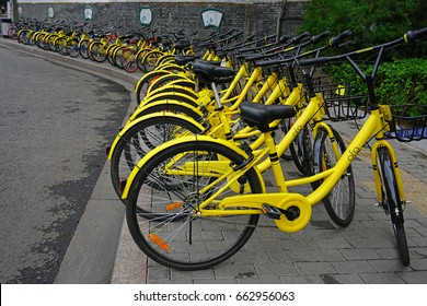 BEIJING, CHINA -5 JUN 2017- View of yellow OFO share bikes lined up in the streets of Beijing. OFO is a Chinese bike sharing start up company.