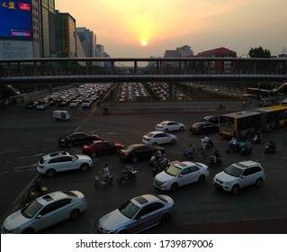 Beijing, Beijing / China - 9 12 2018: Heavy traffic on Beijing road in zhongguancun district as the sun sets on a smog filled day