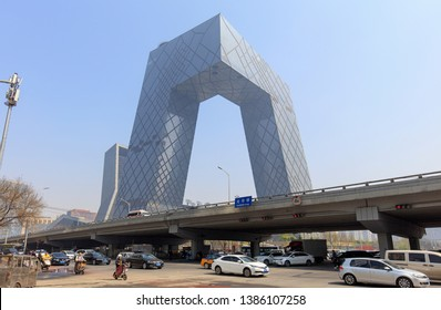 BEIJING, CHINA - APRIL 04, 2019: Unidentified people and traffic are seen around China Central Television (CCTV) Headquarters; it's a 234 m skyscraper.