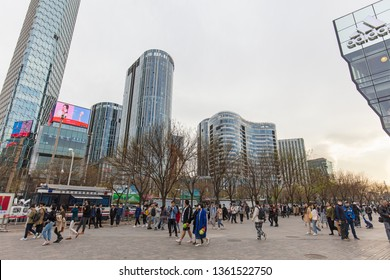 BEIJING, CHINA - APRIL 06, 2019: Crowds of people are seen around the Sanlitun area on the first day of the Qingming or Tomb-Sweeping Festival holiday