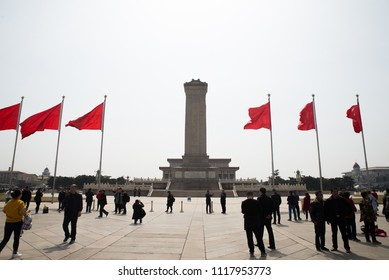 Beijing, China - April 15 2018 - Tienanmen Square and Forbidden Palace Red Flags to represent communistic society during a bright day with guards and officers  Red flags in a row