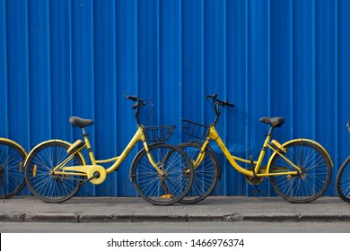 Beijing / China - April 2019 : Two yellow Ofo bike agains a dark blue bacground