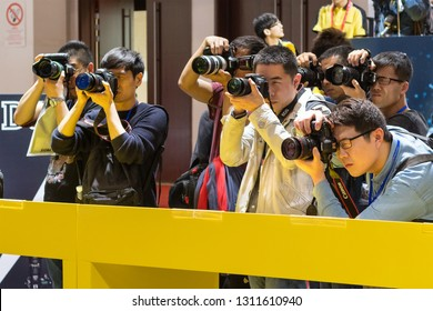 BEIJING, CHINA - APRIL 24, 2016: Visitors are seen taking pictures at the Nikon booth during the 19th China International Photography & Electrical Imaging Machinery and Technology Fair.