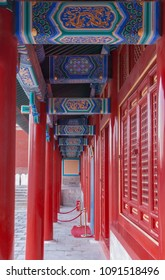 Beijing, China - April 27, 2010: Forbidden City, Look through corridor with series of red pillars and blue beam ornaments on top. One side red painted rooms, other side courtyard.