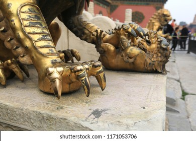 Beijing, China, April 3, 2017. Claws of the golden lion close-up in the Forbidden City in Beijing