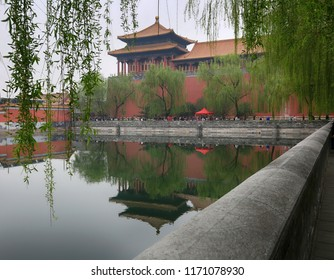 Beijing, China, April 3, 2017. Forbidden City in Beijing and the trees near the pond