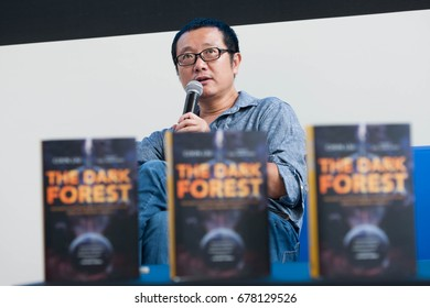 Beijing, China - Aug 29: Famous Chinese science fiction writer Liu Cixin who wrote ' The Three-Body Problem' attends an activity at Beijing International Book Fair on August 29, 2015.