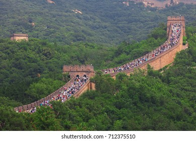 Beijing, China - August 10, 2017: Crowd tourists climb Badaling Great Wall near Beijing. The Ming dynasty walls measure 8,850 km in length, from China's East coast till the Gobi desert in the West.
