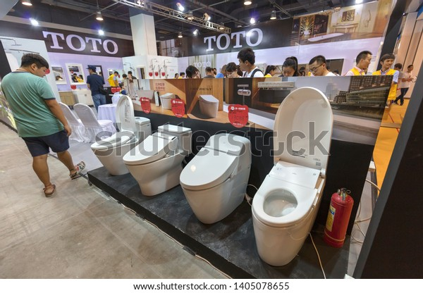 BEIJING, CHINA- AUGUST 12, 2017: A visitor takes a look of TOTO washlets at the TOTO booth during the China Hua Xia Housing and Furnishing Exposition at the China National Convention Center.