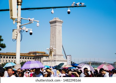 Beijing / China - August 15th 2019: Tiananmen Square Monument to the People's Heroes with cameras overhead and people