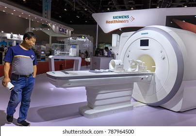 BEIJING, CHINA- AUGUST 19, 2017: A visitor takes a look of a scanner MAGNETOM Amira at the Siemens Healthineers booth during the China International Health Industry Expo (CHINA-HOSPEQ 2017)