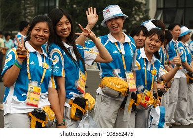 BEIJING, CHINA - AUGUST 24, 2008: Unidentified Olympic volunteers during summer Olympics on August 24, 2008 in Beijing, China. For illustration, comparison and recollection of previous games