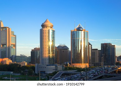 BEIJING, CHINA – August 24, 2020: Skyscrapers with heavy traffic road in Beijing city at sunset