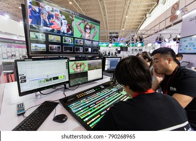 BEIJING, CHINA- AUGUST 26, 2017: Ross technical staff is seen operating production equipment at the Ross booth  during the BIRTV 2017 - Beijing International Radio, TV & Film Exhibition 2017