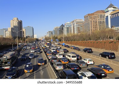 BEIJING, CHINA - DECEMBER 10, 2015: Traffic is seen at city ring road under a blue sky. Beijing issued a red alert for air pollution on Tuesday and was lifted today at noon.