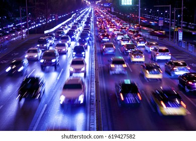 Beijing - China - December 23, 2016: with the increase in cars, traffic jams in Beijing is very serious. The car moved slowly in the rush hour.