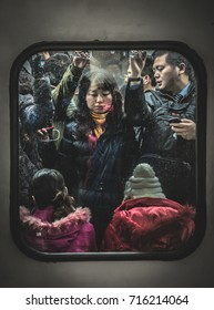 BEIJING, CHINA - DECEMBER 6, 2012: Cramped commuters on the Beijing Metro during rush hour