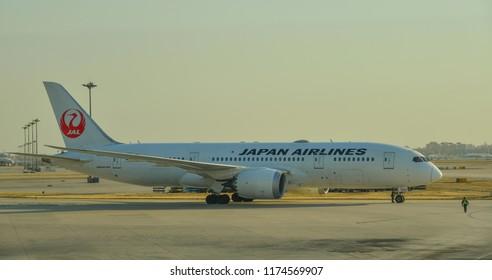Beijing, China - Feb 28, 2018. A Boeing 787 Dreamliner airplane of Japan Airlines (JAL) taxiing on runway at Beijing Capital International Airport (PEK).