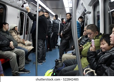 BEIJING, CHINA - FEB 4, 2014 - People inside the Chinese capital's subway