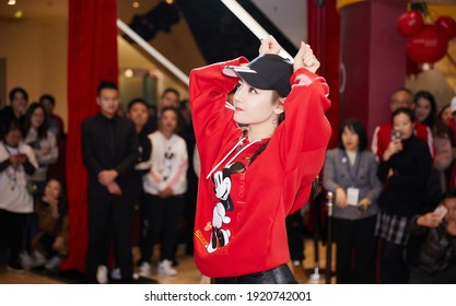 Beijing, china- February 12, 2020: chinese famous actress Dilraba wears red adidas NEO sweater posing