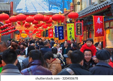 BEIJING, CHINA - FEBRUARY 17, 2015: People crowd the Wangfujing snack street ahead of Chinese New Year celebrations, the year of the sheep, which starts on February 19 this year.