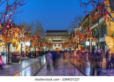 Beijing, China - February 22, 2018: Scene along the Qianmen street leading out from Archery Tower of Qianmen, the most popular shopping street of the city during the Chinese New Year holidays.