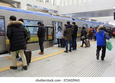 BEIJING, CHINA - FEBRUARY 4, 2016: Many people is seen with suitcases at a subway station as Chinese people prepare to travel home to visit families during the Spring Festival