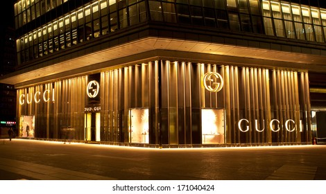 BEIJING, CHINA - JAN. 12, 2014: Gucci store at night. Gucci is an Italian fashion and leather goods brand was founded by Guccio Gucci in Florence in 1921. Gucci has about 425 stores worldwide.
