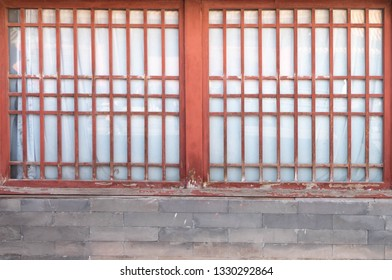 Beijing, CHINA JAN 16 2019: The Forbidden palace - old red door with the paper abd the bricks. The part of inside of the forbidden palace. It's the old chinese style.