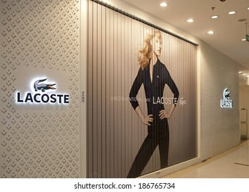 BEIJING, CHINA - JAN 5, 2014: Facade of a  Lacoste store; Lacoste is a French clothing company that sells high-end clothing, footwear, perfume, leather goods, watches, eyewear.