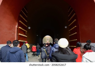BEIJING, CHINA - JANUARY 13, 2017: The  environment of the city with entrance gate viewing and crowd of people in the area of Tian An Men square, Beijing China