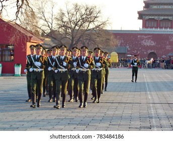 Beijing, China, January 15, 2005: Regimented soldiers marching inside Forbidden City, Beijing, China