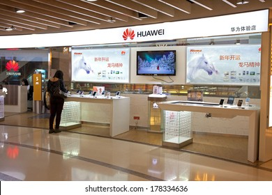 BEIJING, CHINA - JANUARY 2, 2014: People in seen at a Huawei store; Huawei, a Chinese multinational company, is the largest telecommunications equipment maker in the world.