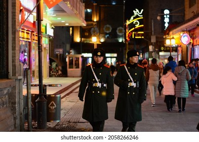 BEIJING, CHINA - JANUARY 24, 2017: The Chinese soldiers on night time to protect and safe situation in peace for Chinese people in the area of Tian An Men square, Beijing China