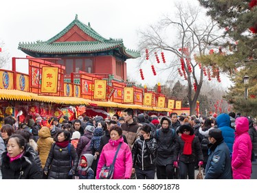 BEIJING, CHINA- JANUARY 29, 2017: People crowd Ditan Park on the second day of the Chinese New Year, the year of the rooster.