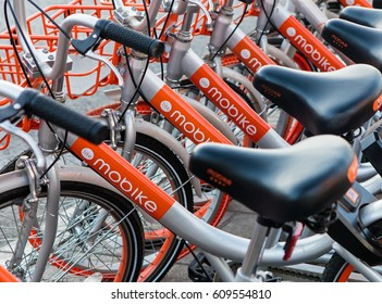 BEIJING, CHINA- JANUARY 30, 2017: Mobike bicycles are seen on city downtown. Mobike was created by Beijing Mobike Technology Co., Ltd. is a bicycle-sharing system deployed in some cities in China.