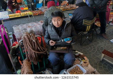 Beijing / China - January 6th 2015: Panjiayuan Antique Market (Beijing Antique Market) is Beijing's biggest and best-known arts, crafts, and antiques market selling second hand goods