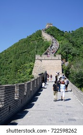 BEIJING, CHINA - JUL 25, 2016: Tourists at the Great Wall of China, pictured on July 25th, 2016.  The fortification is a UNESCO World Heritage Site.