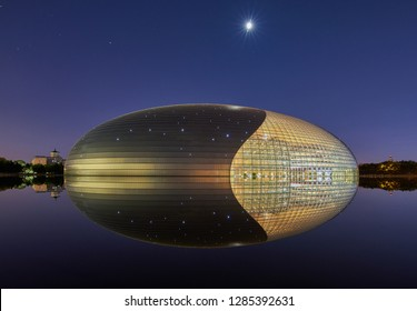 "Beijing / China - July 12th 2016: Night view of National Centre for the Performing Arts (NCPA), colloquially described as ""The Giant Egg"", under the Moonlight Beijing, China."