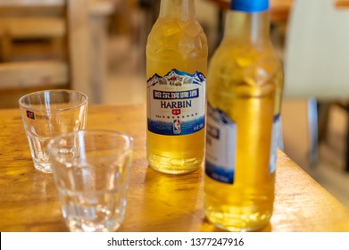 Beijing / China - July 17 2017: Cold bottles of Harbin Beer served in the restaurant