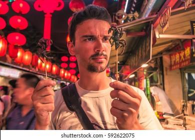 Beijing, China - July 19, 2014: Fried spiders in the Night food market of Wangfujing
