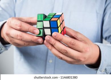 Beijing China - July 19, 2015: Man wearing casual clothes collect Rubik's Cube. Rubik's cube invented by a Hungarian architect Erno Rubik in 1974.