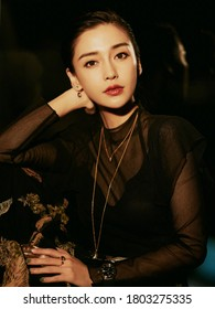 beijing, china- july 26, 2019: chinese famous actress Angela Baby wears black shirt posing