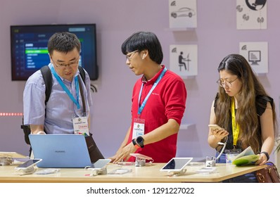 BEIJING, CHINA- JULY 8, 2017:  Visitors try products on display at the Huawei booth during the Beijing International Consumer Electronics Expo held in the China National Convention Center (CNCC).