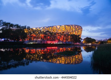 Beijing, China - Jun 21, 2016 : Night view of the National stadium with its reflection at the Beijing Olympic Park.