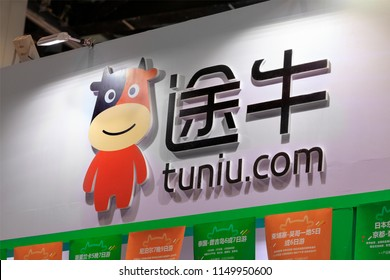 BEIJING, CHINA - JUNE 17, 2017: tuniu.com sign is seen during the Beijing International Fair for Trade in Services and Beijing International Tourism Expo 2017.