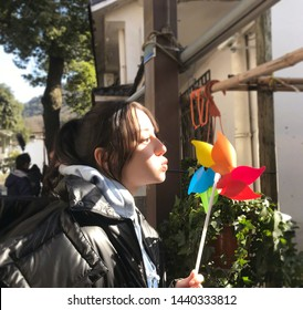 Beijing, china- june 20, 2019: chinese actress Dili reba is Blowing a colorful windmill , sexy and pretty Chinese woman